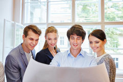 Business team looking at plan Stock Photography