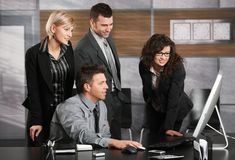 Business team looking at screen Royalty Free Stock Images