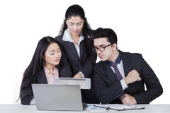 Business team looking at tablet Royalty Free Stock Photography