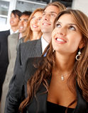 Business team looking up Royalty Free Stock Photo