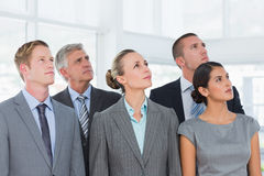 Business team looking up Royalty Free Stock Images