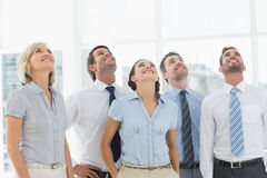 Business team looking up in office Stock Images