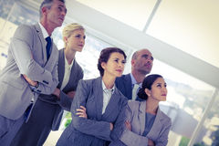 Business team looking up together Stock Images