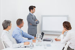 Business team looking at white screen Stock Images
