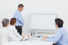 Business team looking at white screen Stock Photo