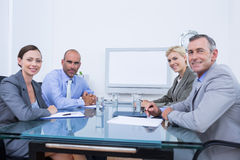 Business team looking at white screen Stock Image