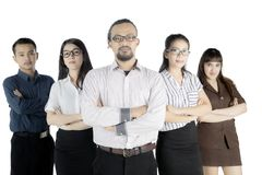 Business team looks confident on studio. Group of diversity business team standing in the studio with folded arms, isolated on white background Royalty Free Stock Photo