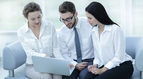Business team looks at the information on the laptop Royalty Free Stock Photo