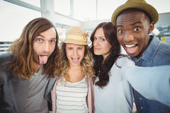 Business team making face while taking self portrait Royalty Free Stock Images