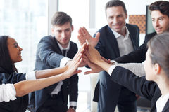 Business team making high five Stock Photo
