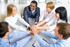 Business team making pile of hands on working place Royalty Free Stock Photo