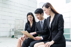 Business team mamber read on clipboard Stock Images