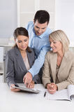Business Team: Man and woman group in a meeting talking about fa stock image