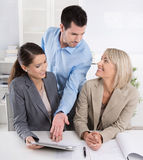 Business Team: Man and woman group in a meeting talking about fa Stock Photo