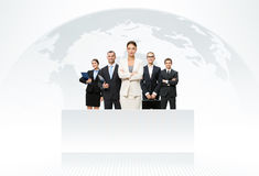 Business team with map of the world in background. International business team with map of the world in background Royalty Free Stock Photos