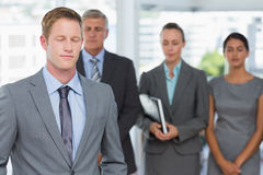 Business team meditating eyes closed Stock Photography