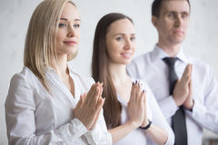 Business team meditating Royalty Free Stock Images