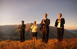 Business Team Meditating Mountains Concept Stock Image