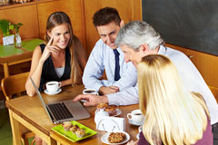 Business team meeting in café Stock Photos