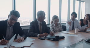 Business team meeting in conference room stock video