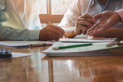 Business team meeting and discussing project plan. Businessmen discussing together in meeting room. Professional investor working with business project Stock Images