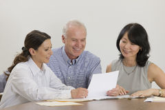 Business team meeting with documents. Royalty Free Stock Photos