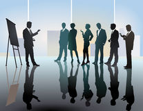 Business team meeting or lecture. Silhouette of man standing in front of a group of people attending a meeting or lecture Royalty Free Stock Photo