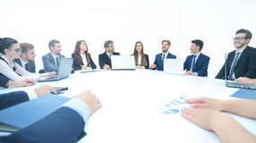 Business team at the meeting listens to the report of the chief Stock Photo