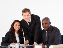 Business team in a meeting looking at the camera Stock Images