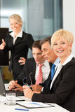 Business - team meeting in an office Royalty Free Stock Photography