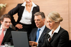 Business - team meeting in an office. With laptop, the boss with his employees Royalty Free Stock Photography