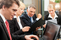 Business - team meeting in an office. With laptop, the boss with his employees Royalty Free Stock Image