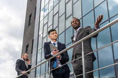 Business team meeting outdoors near office building Stock Images