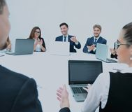 Business Team Meeting Seminar Training Concept. Collegues workin. Business team, sitting at athe round table on white background. concept of success Stock Photos