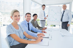 Business team during meeting smiling at camera Stock Images