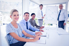 Business team during meeting smiling at camera Stock Photography