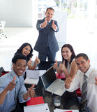 Business team in a meeting with thumbs up Stock Photography