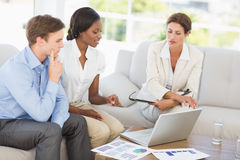 Business team meeting to go over figures on the couch Stock Image