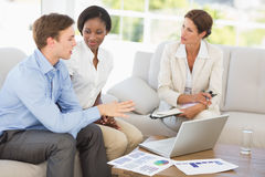 Business team meeting to go over numbers on the couch Royalty Free Stock Photos