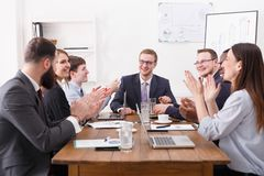 Business team meeting at white office siterior. Employees clapping hands cheering successful reporter Royalty Free Stock Photography