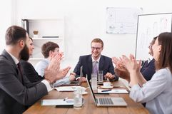 Business team meeting at white office siterior. Workers clapping hands cheering successful reporter Stock Images