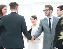Business team meets business partners in the office.a friendly h Stock Photography