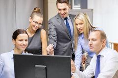 Business team with monitor having discussion Royalty Free Stock Photography
