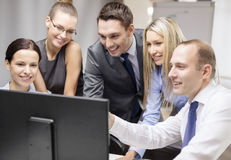 Business team with monitor having discussion Royalty Free Stock Images