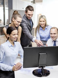 Business team with monitor having discussion Stock Photography