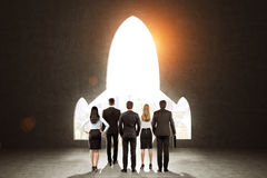 Business team near a black wall with a plane shaped opening Stock Photos