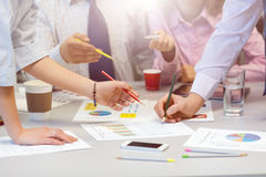 Business Team networking - office Table with Charts and People Hands. Business Team networking Concept - grey Office Table with many printed professional Paper royalty free stock photo