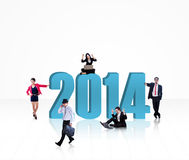 Business team with the new year 2014 - isolated. Business people with the new year 2014 isolated on white background Royalty Free Stock Photography