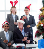 Business team with novelty Christmas hat. Toasting at a party in the office Stock Photo