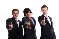 Business team, offering to shake hands. Isolated in white background stock photo